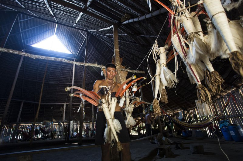Indigenous person from the Yaigojé Apaporis reservation prepares a traditional costume for an Amazonian ritual.