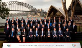 Be-suited officials in front of Sydney Harbour
