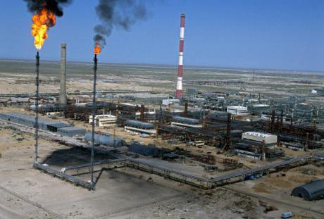 Flames move as excess gas is burned off at a Kazakh oil refinery.