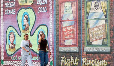 Girls on front of murals in belfast. Flickr:Anna & Michal. Some rights reserved.jpg