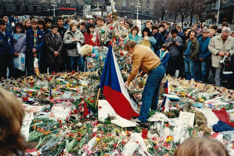Vaclav Havel and protesters commemorate the struggle for Freedom and Democracy at Prague memorial during 1989 Velvet Revolution.