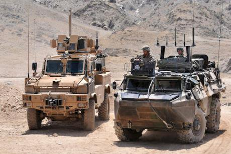 Two ISAF troop carriers in Afghanistan.