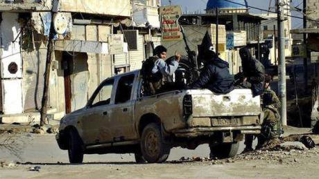 IS fighters in Raqqa with captured weapons, Jan 2014. AP Photo/Militant Website. All rights reserved.