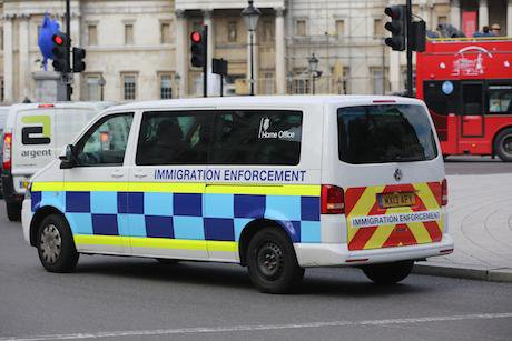 White van with immigration enforcement written on the side
