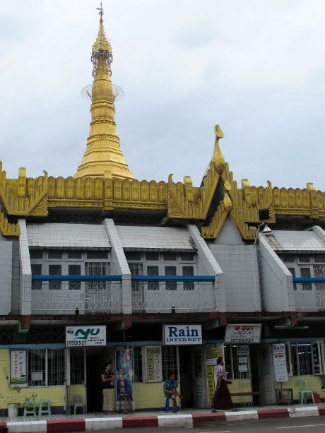 Road-side internet cafes with golden pagoda in background