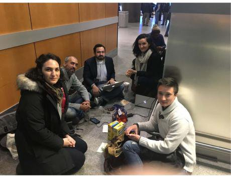 Intrepid CUNY law students in a makeshift outpost at JFK.jpg
