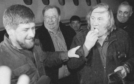 Ramzan Kadyrov with Gerard Depardeiu, eating a crisp.