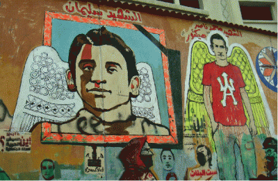 Male figures with angels's wings. One wearing red El Ahly tee-shirt