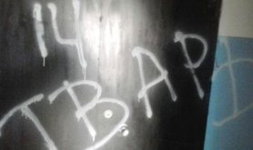 The word 'beast' daubed across Aleksandr Lashmankin's flat. His address had been posted online.