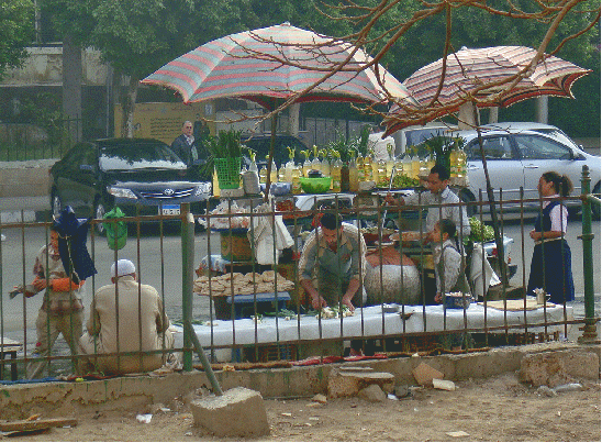 Vendors underneath umbrellas
