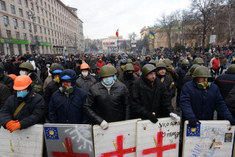 Formidable Looking Euromaidan activists with shields, hardhats and face coverings.