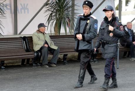 A Cossack and police officer patrol the streets of Sochi during the 2014 Winter Olympics. (c) RIA Novosti/Maksim Bogodvid