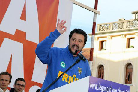 Matteo Salvini animatedly speaking from a podium.