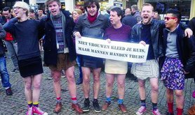 Men in mini-skirts pose for photographs at the start of the Amsterdam mini-rok protest. Jess Graham.All rights reserved.