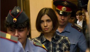 Tolokonnikova escorted by police during her trial.