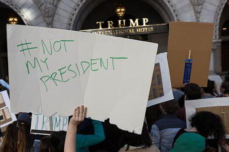 Not_My_President,_Protesters_outside_Trump_Hotel_on_Pennsylvania_Ave,_DC_(30603012530).jpg
