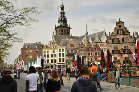 Historic, oldest city in Holland, walkers at forefront, cafes in background