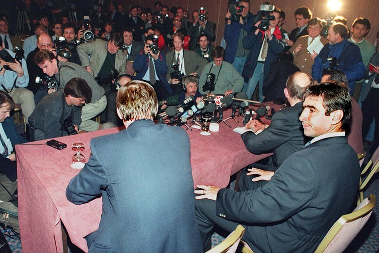 Man. United soccer star Eric Cantona with Alex Ferguson, at a news conference after the FA disciplinary hearing in St Albans, Feb.1995.