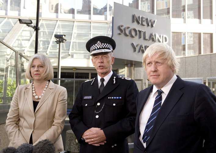 New Metropolitan Police Commissioner stands with Home Secretary Theresa May and Mayor of London Boris Johnson outside New Scotland Yard, London, September, 2011.