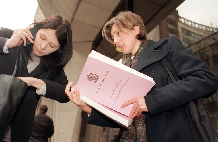 Journalists collect a copy of the long-awaited Stephen Lawrence Inquiry report by Sir William Macpherson, from the Home Office. Feb 24, 1999.