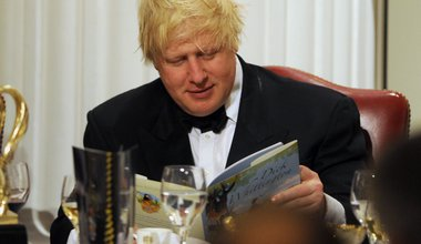 Boris Johnson with a copy of Dick Whittington during the Lord Mayor of the City of London's annual London Government Dinner at Mansion House, London. 17-Jan-2013
