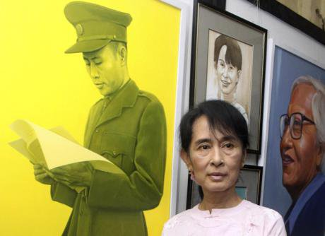 Aung San Suu Kyi poses by a painting of her father, Gen. Aung San. (Khin Maung Win AP/PA)