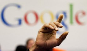A man raises his hand in Google office.