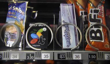 Vending machine with snacks and condoms, Berlin, Germany.