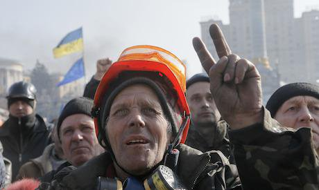 Protester gives the victory sign during a rally in Independence Square, Kiev in February 2014. Credit: Efrem Lukatsky / AP/Press