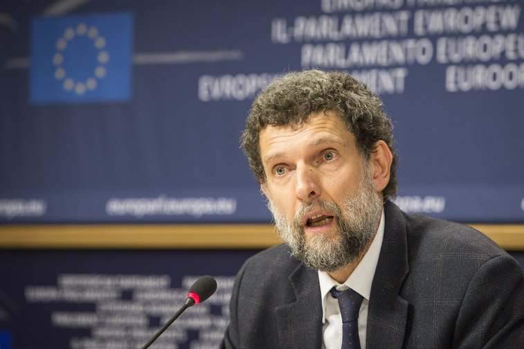 Osman Kavala speaking at the European Parliament headquarters in Brussels in 2014.