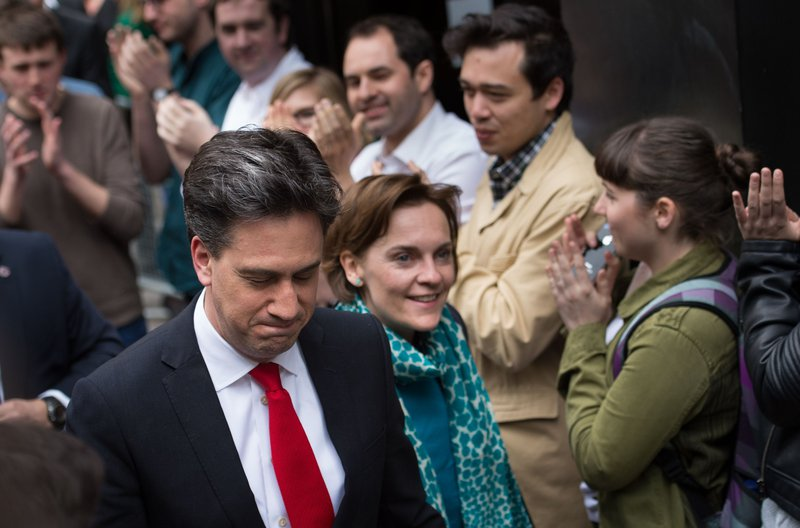Labour leader Ed Miliband is greeted by staff as he arrives with his wife Justine at the Labour party central office in Brewer's Green, before delivering his resignation speech at 1 Great George street, London, 8 May 2016
