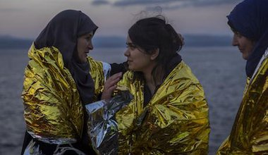 Three women arrive on Lesbos. AP Photo/Santi Palacios. All rights reserved.