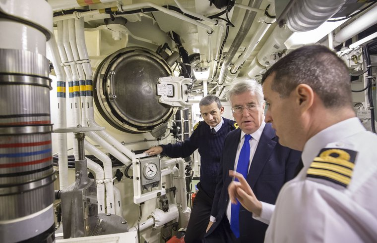 Then Defence Secretary Michael Fallon with Rear Admiral of Submarines and Assistant Chief of Naval Staff John Weale and Daniel Martyn Commanding Officer of HMS Vigilant, in the missiles compartment. January, 2016.