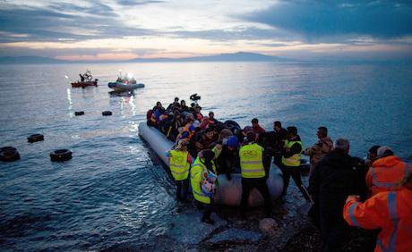 Refugees arrive at Lesbos, 2016. Kay Nietfeld/DPA/PA Images. All rights reserved.
