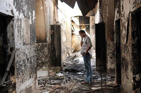 An MSF worker surveys the destruction of the hospital in Kunduz, October 2015. Najim Rahim/AP/Press Association Images.