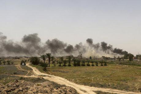 Smoke from IS positions outside Fallujah, May 2016. Khalid Mohammed/AP/Press Association Images. All rights reserved.
