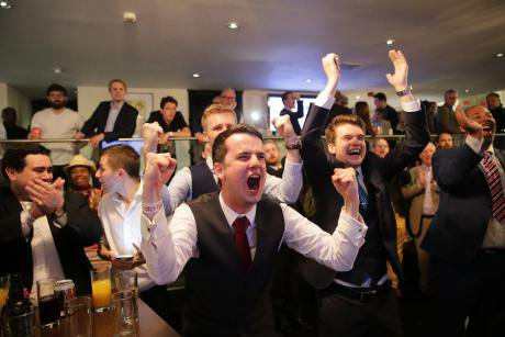 Brexit supporters celebrate the referendum result, 24 June 2016.