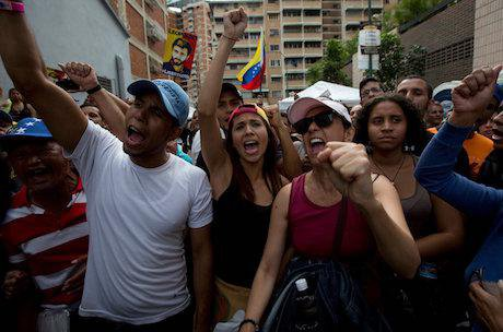 Opposition members chant in Caracas Venezuela. Credit: Fernando Llano/AP/Press Association Images. All rights reserved.