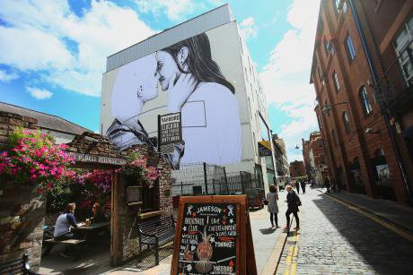 A mural of two women kissing in Belfast, 2016.