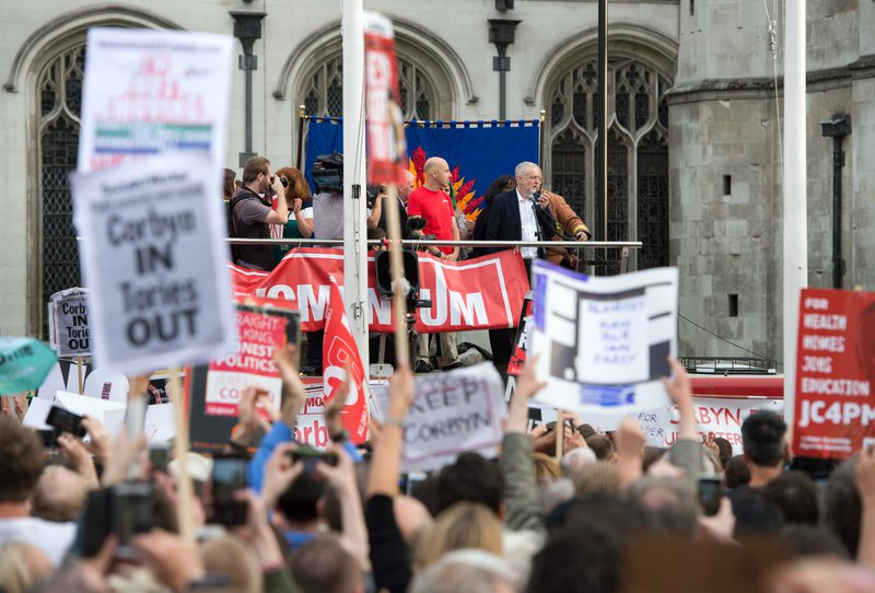 "Jeremy Corbyn speaks in Parliament Square, where the Momentum campaign group are holding a ""Keep Corbyn"" demonstration., 27 June 2016"