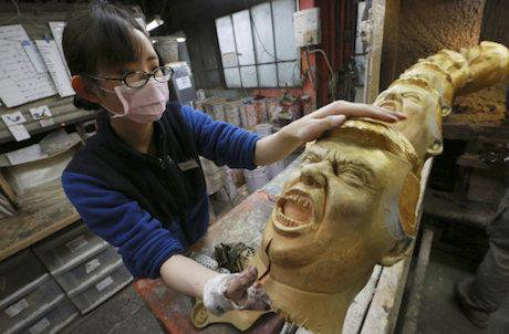 Trump mask production line, Japan. Eugene Hoshiko/AP/Press Association Images. All rights reserved.