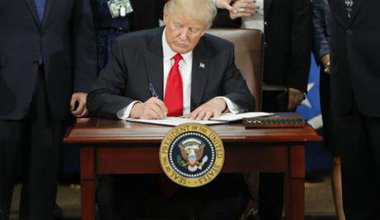 Donald Trump signing documents