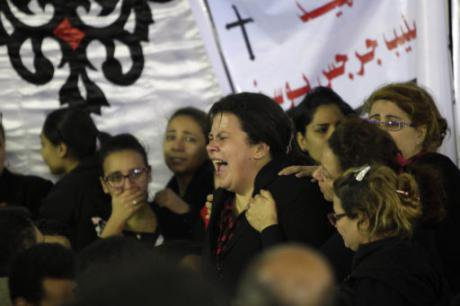 Relatives cry at the church blast victims' funeral in Tanta city