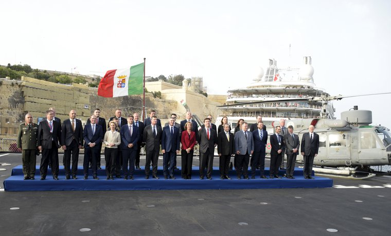 EU Defense Ministers pose for a group photo on board the Italian Amphibious ship San Giusto in Malta taking part in the operation SOPHIA tackling piracy and human trafficking, April, 2017. Xinhua/PA. All rights reserved.