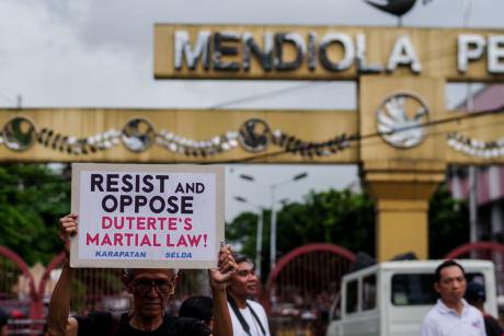 Protesters call for an to end martial law in Mindanao.
