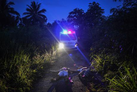 Bodies of two men by the road in Quezon City.