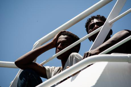 Migrants on a boat near Salerno, Italy.