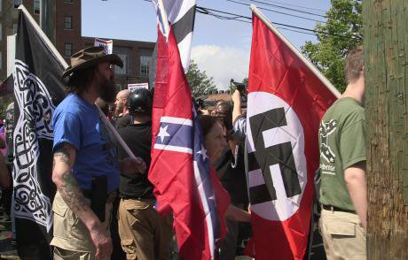 Demonstrators carry confederate and Nazi flags during the Unite the Right rally in Charlottesville, Virginia, August 2017.