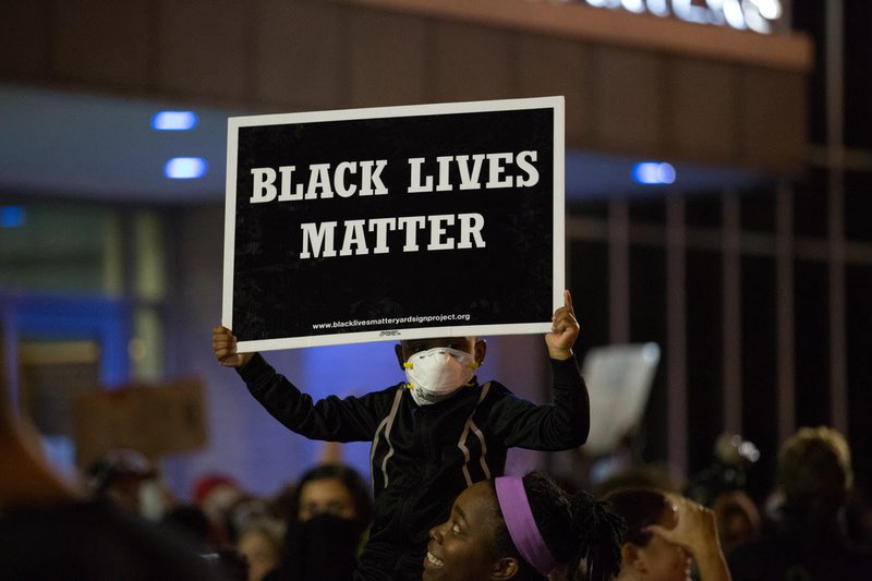 Protester holds up a Black Lives Matter sign at a protest in St Louis in September 2017