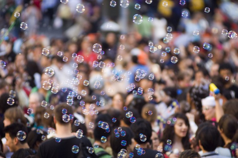 Blowing bubbles in New York's Times Square.